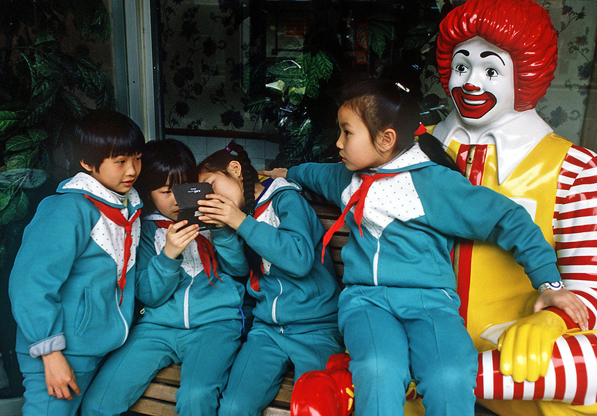 Chinese students congregate at a Shanghai McDonalds after school. © 1998 Mark Avery/Orange County Register