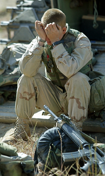 L/Cpl. Philip Cashman of Syracuse, NY, is overcome after a firefight in the streets of Baghdad. © 2003 Mark Avery/Orange County Register