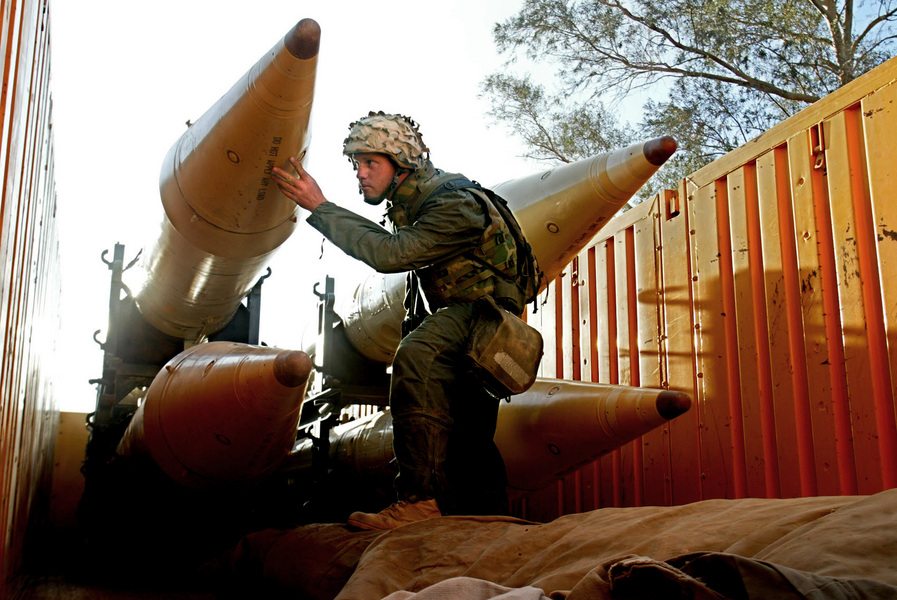 L/Cpl. Jesse Cavender of San Jose checks out four Frog 5 missiles found by US Marines in Baghdad. © 2003 Mark Avery/Orange County Register
