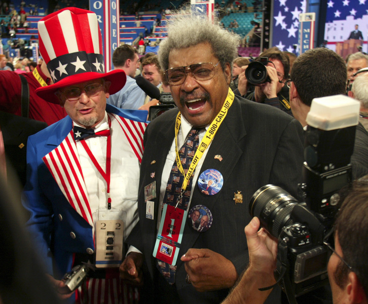 Texas delegate Wade Webster, left, and boxing promoter Don King get a lot of media attention on the floor of the Republican National Convention in New York. © 2004 Mark Avery/Orange County Register