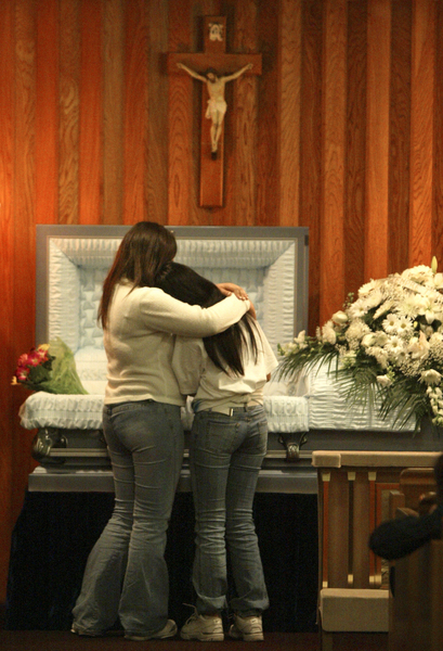 Friends of drive-by shooting victim Cesar Gutierrez, 14, of Buena Park hold each other as they view the body during a memorial in Anaheim. © 2005 Mark Avery/Orange County Register